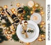 christmas table setting. gold... | Shutterstock . vector #745762138
