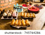 cakes on a sweet table and... | Shutterstock . vector #745764286