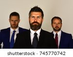 businessmen wear smart suits... | Shutterstock . vector #745770742