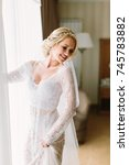 happy bride is dressed for a... | Shutterstock . vector #745783882
