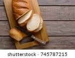 sliced bread on wooden table.... | Shutterstock . vector #745787215