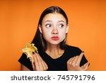 beautiful sad girl in a black t ... | Shutterstock . vector #745791796