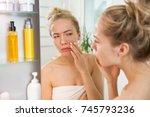 young beautiful woman touching... | Shutterstock . vector #745793236