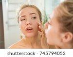 young beautiful woman touching... | Shutterstock . vector #745794052