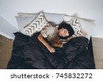 young woman sleeps in bed  in... | Shutterstock . vector #745832272