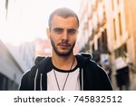 portrait of serious calm young... | Shutterstock . vector #745832512