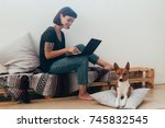 pretty woman works from home or ... | Shutterstock . vector #745832545