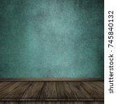 empty wooden table over grunge... | Shutterstock . vector #745840132