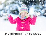 child playing with snow in... | Shutterstock . vector #745843912