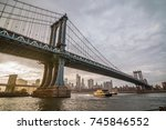 manhattan bridge at sunset with ... | Shutterstock . vector #745846552