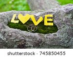 bright yellow maple leaves on... | Shutterstock . vector #745850455