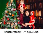 parents pose with their little... | Shutterstock . vector #745868005