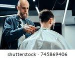 barbershop theme. bald barber... | Shutterstock . vector #745869406