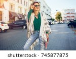 beautiful stylish woman walking ... | Shutterstock . vector #745877875