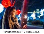 smiling teenage girl on the... | Shutterstock . vector #745883266