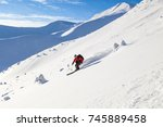 good skiing in the snowy... | Shutterstock . vector #745889458