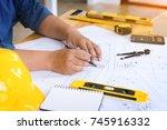 engineer man working with... | Shutterstock . vector #745916332