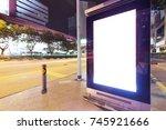 blank billboard on street in... | Shutterstock . vector #745921666