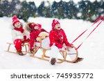 little girl and boy enjoy a... | Shutterstock . vector #745935772