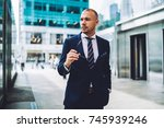 serious young trader in elegant ... | Shutterstock . vector #745939246