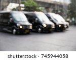blur of vip luxury black van.... | Shutterstock . vector #745944058