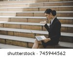 young woman sitting on... | Shutterstock . vector #745944562