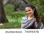 Smiling young woman in the park - stock photo
