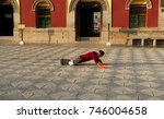 Small photo of On August 16, 2017 kumbum monastery in qinghai, China.A buddhist believers kowtow.Kowtow is a belief of Tibetan buddhist believers pray, in order to avoid the disaster is the most devout prayer.