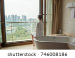 young woman on white bath in... | Shutterstock . vector #746008186