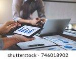 business team meeting working... | Shutterstock . vector #746018902
