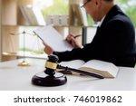 judge gavel with justice... | Shutterstock . vector #746019862