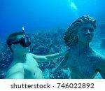 underwater wide angle selfie of ... | Shutterstock . vector #746022892