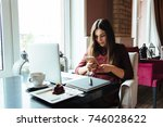 young attractive woman sitting... | Shutterstock . vector #746028622