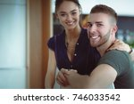 beautiful young couple is... | Shutterstock . vector #746033542