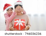 making a surprise for christmas ... | Shutterstock . vector #746036236