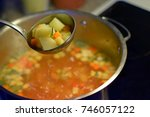 ladle with vegetable soup.... | Shutterstock . vector #746057122