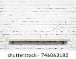 wooden shelf over white brick... | Shutterstock . vector #746063182