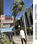 Small photo of LOS ANGELES, OCT 11TH, 2017: A doctor walks past the Emergency room sign on Gracie Allen Drive, at famous Cedars Sinai Medical Center hospital in Los Angeles, where many celebrities have been treated.