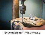 hand of worker man drills a...   Shutterstock . vector #746079562