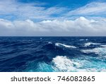 Clouds And Waves In Pacific