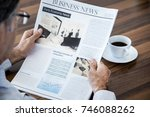 senior man reading newspaper | Shutterstock . vector #746088262