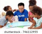 young male volunteer reading... | Shutterstock . vector #746112955