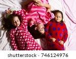 girl friends in pajamas sleep... | Shutterstock . vector #746124976