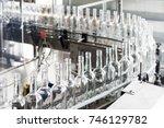 empty glass bottles on the... | Shutterstock . vector #746129782