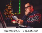 worried men cheeking his mail... | Shutterstock . vector #746135302
