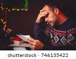 worried men cheeking his mail... | Shutterstock . vector #746135422