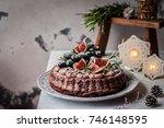 chocolate christmas cake... | Shutterstock . vector #746148595
