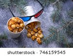 aramelized popcorn and 3d... | Shutterstock . vector #746159545