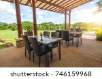 Summer terrace of the restaurant. Dining table in the open air in morning In the midst of the natural scenery.