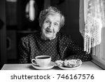 elderly woman drinking tea at... | Shutterstock . vector #746167576